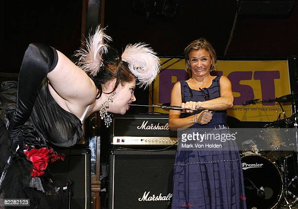 Performer Lady Aye of Lady Circus gets a sword pulled out of her mouth with the help of Amy Sedaris at the Bust Magazine's 15th Anniversary...