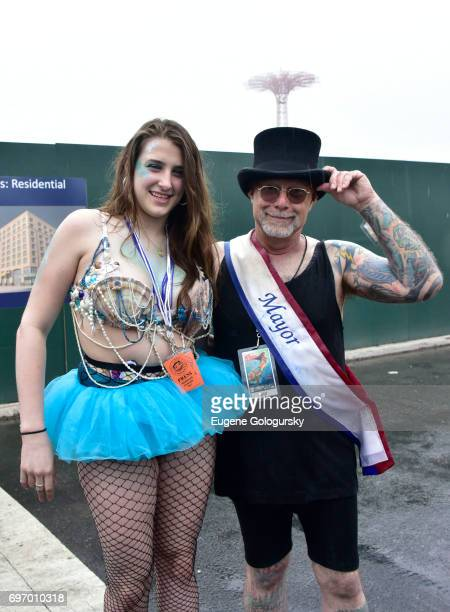 Performer Leah Lane and Mermaid Parade Founder Dick D Zigun attend The Mermaid Parade Coney Island USA at Coney Island on June 17 2017 in New York...