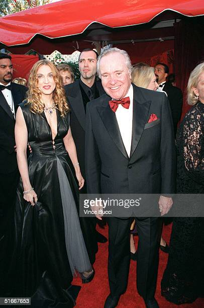 Performer Madonna her brother Chris and actor Jack Lemmon arrive for the 70th Annual Academy Awards 23 March 1998 in Los Angeles CA AFP PHOTO/Vince...