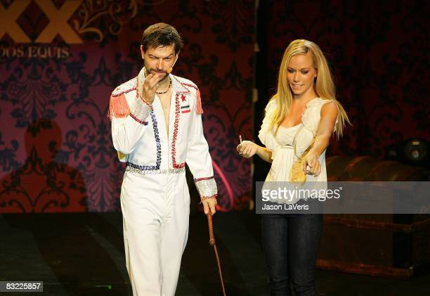 Performer Mark The Knife Faje and TV personality Kendra Wilkinson onstage at The Most Interesting Show in the World presented by Dos Equis at The...