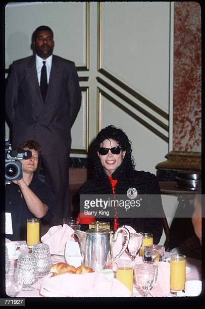Performer Michael Jackson sits at an award ceremony held by CBS Records February 20 1990 in Los Angeles CA Jackson who was the lead singer for the...