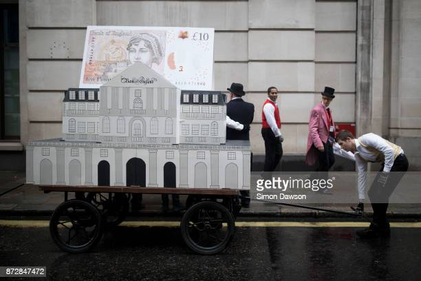 A performer moves a float from the Bank of England before marching in the Lord Mayor's Show on November 11 2017 in London England The Lord Mayor's...