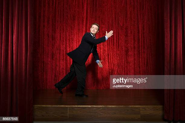 performer on stage - vaudeville stock pictures, royalty-free photos & images