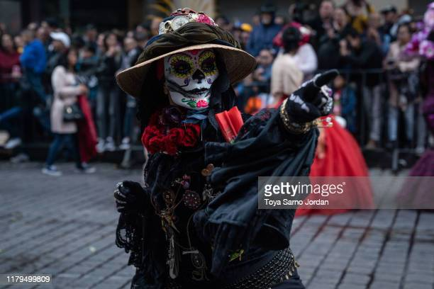 A performer participates in the Day of the Dead parade on Paseo de la Reforma Avenue on November 2 2019 in Mexico City Mexico Observants celebrate...