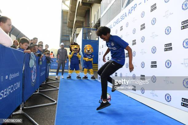 Performer performs some football skills outside the stadium prior to the Premier League match between Chelsea FC and Manchester United at Stamford...