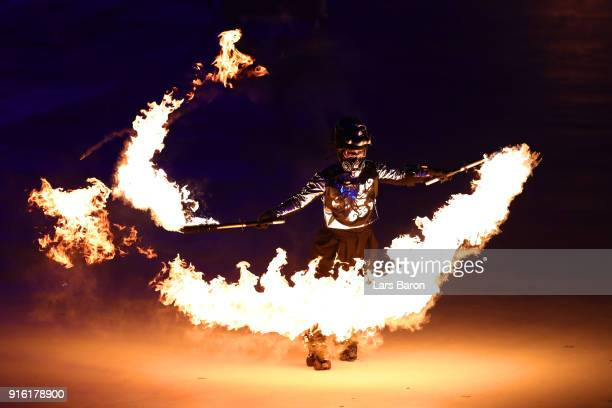 A performer plays with fire during the Opening Ceremony of the PyeongChang 2018 Winter Olympic Games at PyeongChang Olympic Stadium on February 9...
