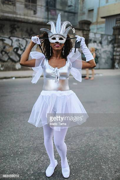 A performer poses before parading outside the Sapucai Sambodrome on February 14 2015 in Rio de Janeiro Brazil This year's official Carnival...