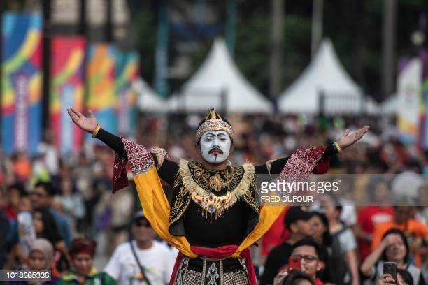 TOPSHOT A performer poses in an alley before the opening ceremony of the 2018 Asian Games at the Gelora Bung Karno main stadium in Jakarta on August...