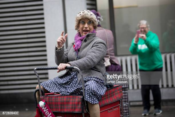 A performer reacts as he moves on a motorised vehicle before participating in the Lord Mayor's Show on November 11 2017 in London England The Lord...