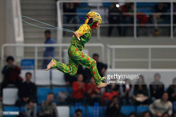A performer rope skipping Jumped off the10 meter platform after the Women's 3m Synchro Springboard Final during day one of the FINA/Midea Diving...
