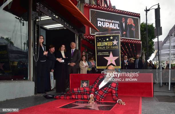 Performer RuPaul poses at his just unveiled Star at his Hollywood Walk of Fame ceremony on March 16 2018 in Hollywood California / AFP PHOTO /...