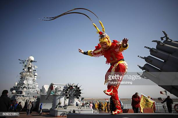 Performer seen in the Monkey King costume works on the retired aircraft carrier Kiev at a theme park during the second day of Chinese lunar new year...