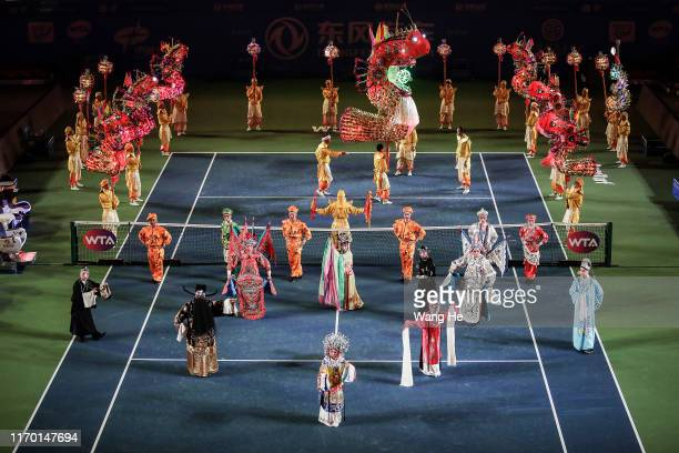 Performer shows Peking opera at the opening ceremony of 2019 Dongfeng Motor Wuhan Open at Optics Valley International Tennis Center on September 22...
