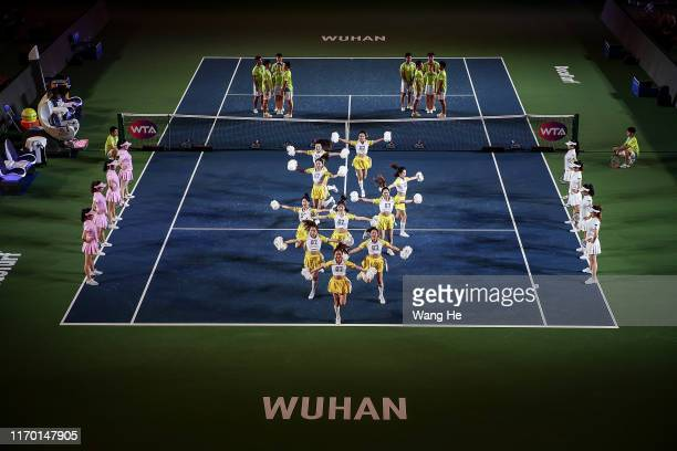 Performer shows tennis dance at the opening ceremony of 2019 Dongfeng Motor Wuhan Open at Optics Valley International Tennis Center on September 22...