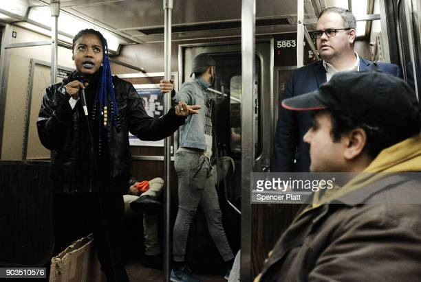 A performer sings on a the subway on January 10 2018 in New York City The New York City subway system which opened in 1904 and is the world's largest...