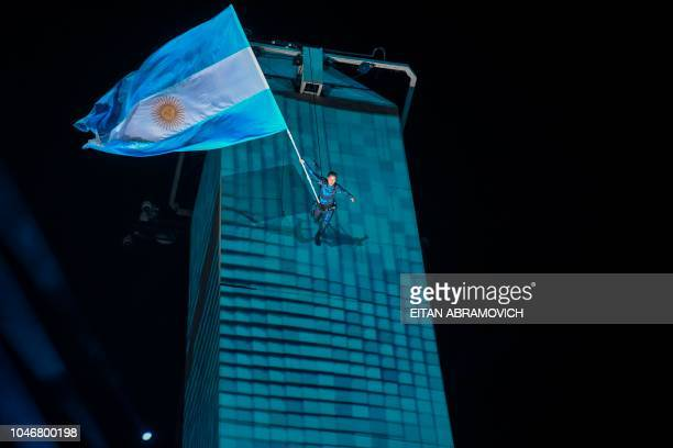 A performer takes part in the opening ceremony of the 2018 Youth Olympic Games at the Obelisk in Buenos Aires on October 6 2018