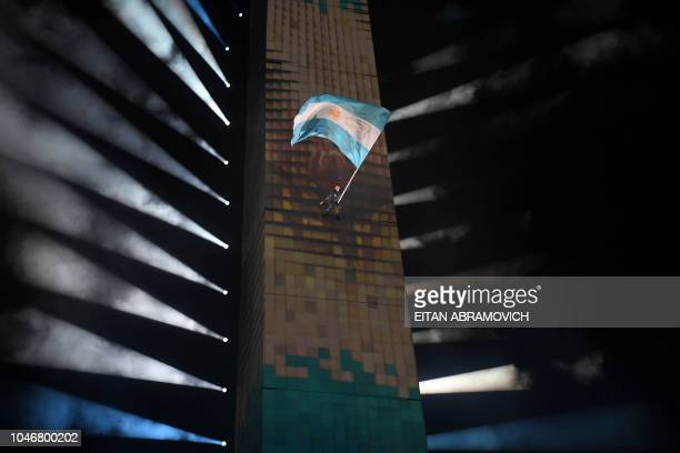 TOPSHOT A performer takes part in the opening ceremony of the 2018 Youth Olympic Games at the Obelisk in Buenos Aires on October 6 2018