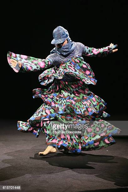 A performer takes the runway at the KENZO x HM Launch Event Directed By JeanPaul Goude' at Pier 36 on October 19 2016 in New York City