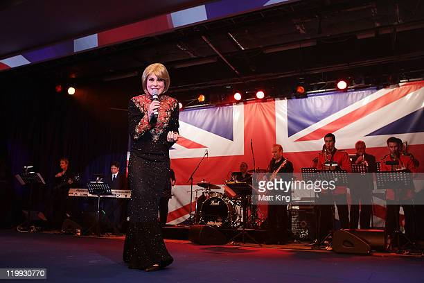 Performer Tamsin Carroll sings on stage during the Australian Olympic Committee Black Tie Dinner at the Sydney Convention Exhibition Centre on July...