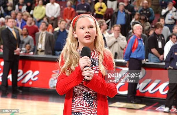 Performer Taylor Swift sings the National Anthem prior to the game of the Detroit Pistons against the Philadelphia 76ers on April 5 2002 at the...