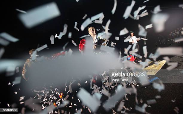Performer tosses confetti on the crowd on opening night of the Coney Island Boom A Ring! presented by Ringling Brothers and Barnum and Bailey Circus...