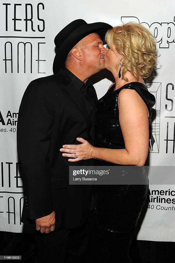 Performer Trisha Yearwood and inductee Garth Brooks attend the Songwriters Hall of Fame 42nd Annual Induction and Awards at The New York Marriott Marquis Hotel - Shubert Alley on June 16, 2011 in New York City.