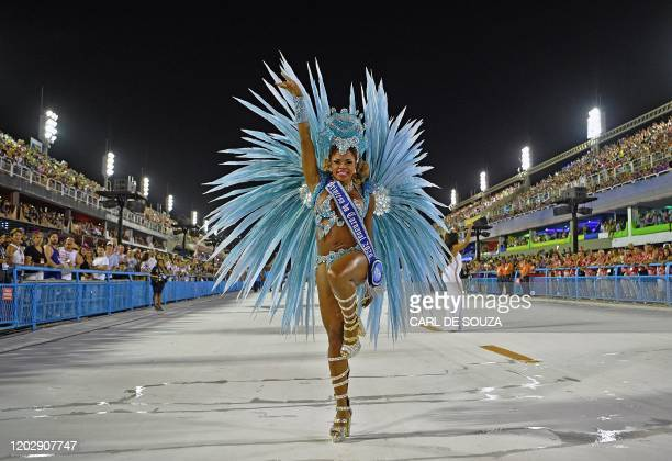 TOPSHOT A performer uses his mobile phone before the beginning of the first night of carnival parade at the Sambadrome in Rio de Janeiro Brazil on...