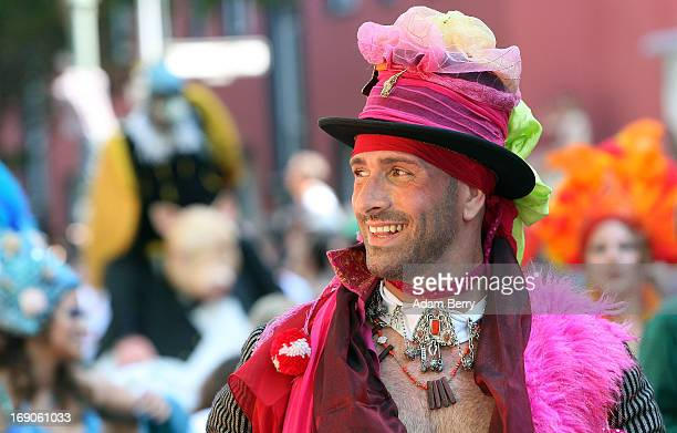 A performer walks during the annual Carnival of Cultures parade in Kreuzberg district on May 19 2013 in Berlin Germany The carnival in German called...