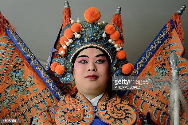 A performer wearing a Cantonese opera costume looks on before an event promoting the upcoming Hong Kong Sevens rugby tournament in Hong Kong on March...