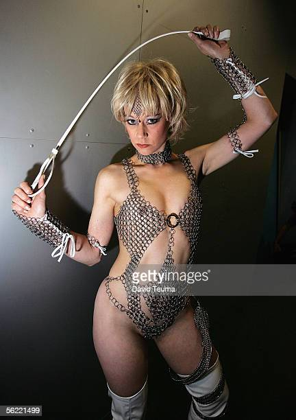 A performer wearing a Marquis de Sade fashion design poses during the 2005 Sexpo at The Exhibition Centre in Southbank November 18 2005 in Melbourne...
