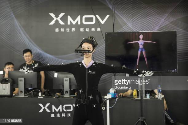 A performer wearing a motion capture suit displays the rendering capability of Xmov at the booth of Xmov Konjac a unit of Konjac Information...