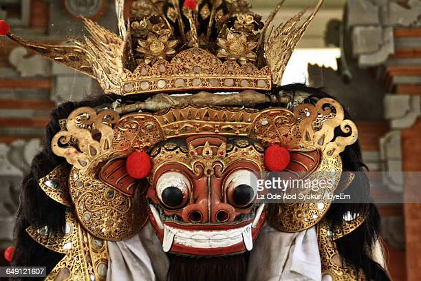 performer wearing mask during barong dance - balinese culture stock pictures, royalty-free photos & images