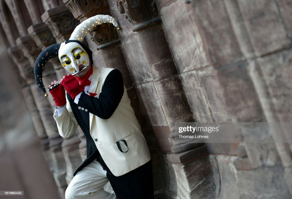A performer wearing the 'Ueli' costume plays a piccolo after the traditional 'Morgestraich' of the Basel Fasnacht Carnival on February 18, 2013 in Basel, Switzerland. More than 12,000 participants will take part in the largest carnival in Switzerland that lasts for 72 hours and will be watched by more than 100,000 spectators as it makes its way through the city center.