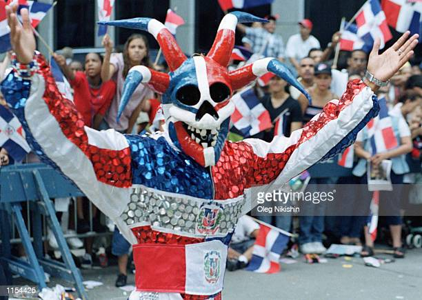 A performer wears a colorful costume during the Dominican Republic Day parade on 6th Avenue in Manhattan August 15 1999