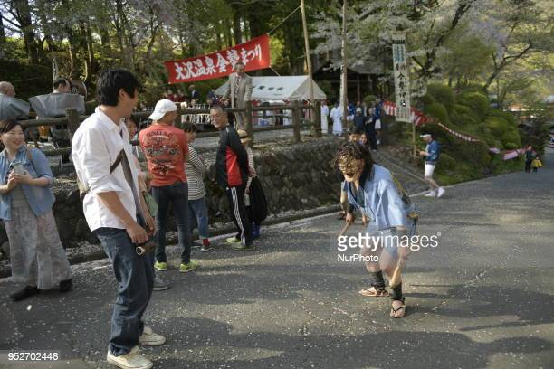 Performer with mask tease festival goer with wooden phallus during the Konsei Festival Fertility Festival at Osawa Onsen in Hanamaki on April 29...