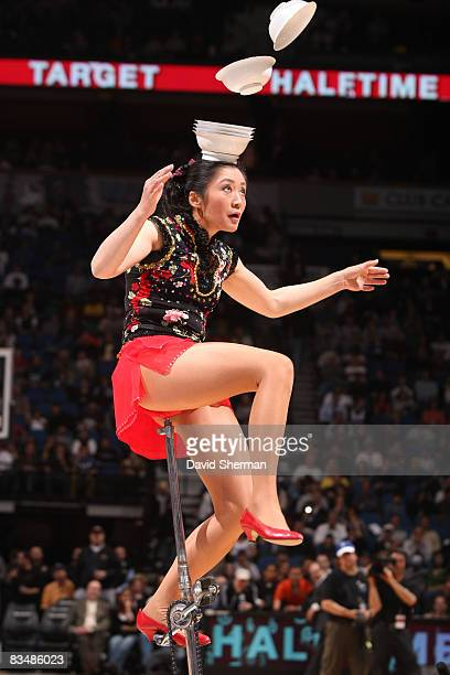 A performer with the group Red Panda performs during halftime when the Minnesota Timberwolves play against of the Sacramento Kings to open the...