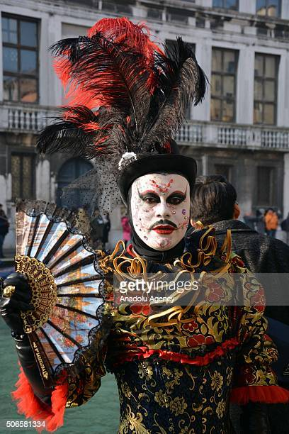 A performer worn a mask and an interesting costume poses near the Cannaregio Canal for the Carnival Regatta during the Venice Carnival on January 24...