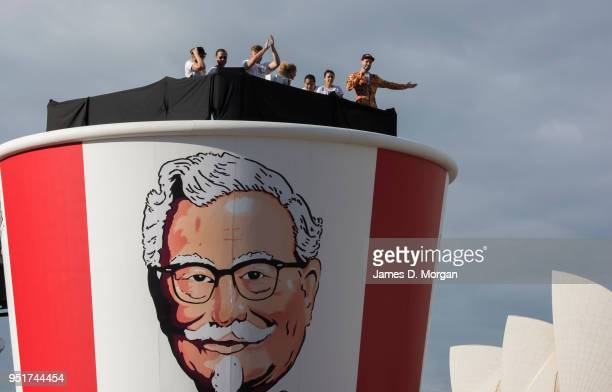 A performer yells to the crowds atop a gigantic Kentucky Fried Chicken bucket to celebrate it's 50th birthday in Australia measuring six metres tall...