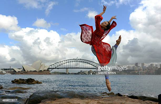 Performer Zhang Yashu from a Chinese ballet company perform during a photo shoot in front of the Australia's iconic landmarks Opera House and Habour...