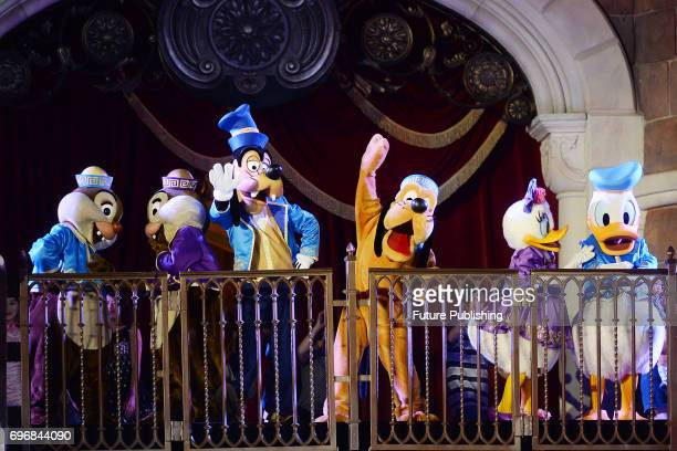Performers act in the celebration show marking the first anniversary of the Shanghai Disney Resort at the 1968foot Enchanted Storybook Castle on June...
