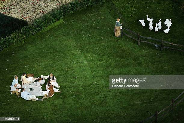 Performers act out a scene from ancient times during the Opening Ceremony of the London 2012 Olympic Games at the Olympic Stadium on July 27 2012 in...
