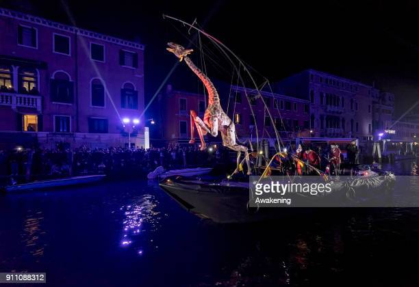 Performers and a life size giraffe prop sail along the Canaregio Canal during the opening of the 2018 Venice Carnival on January 27 2018 in Venice...