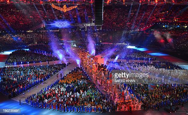 Performers and athletes take part in the Olympic stadium during the closing ceremony of the 2012 London Olympic Games in London on August 12, 2012....