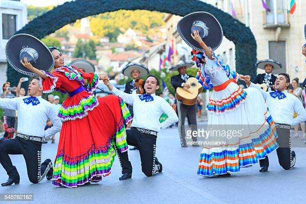 Performers and mariachi from Mexican group performing on street