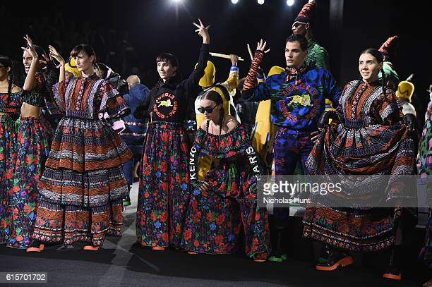 Performers and models take the runway during KENZO x HM Launch Event Directed By JeanPaul Goude' at Pier 36 on October 19 2016 in New York City