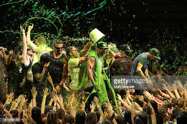 Performers and special guests slime the audience and each other during the Nickelodeon Slimefest 2013 evening show at Sydney Olympic Park Sports...