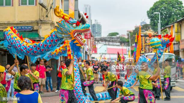 performers are performing traditional chinese dragon dance - animal representation stock pictures, royalty-free photos & images