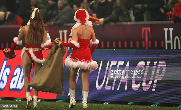 Performers are seen during the half time break at the UEFA Cup Group F match between Bayern Munich and Aris Saloniki at the Allianz Arena on December...