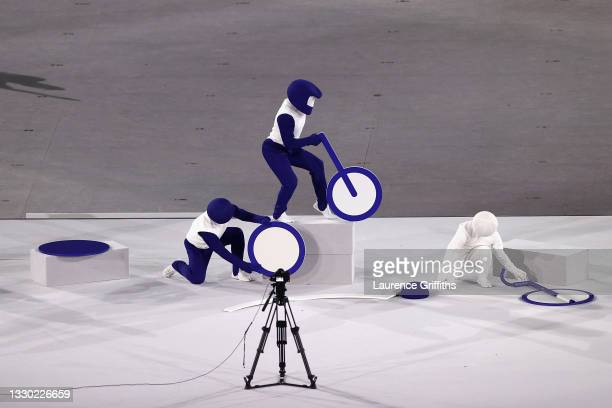 Performers are seen with the Olympic Cauldron during the Opening Ceremony of the Tokyo 2020 Olympic Games at Olympic Stadium on July 23, 2021 in...