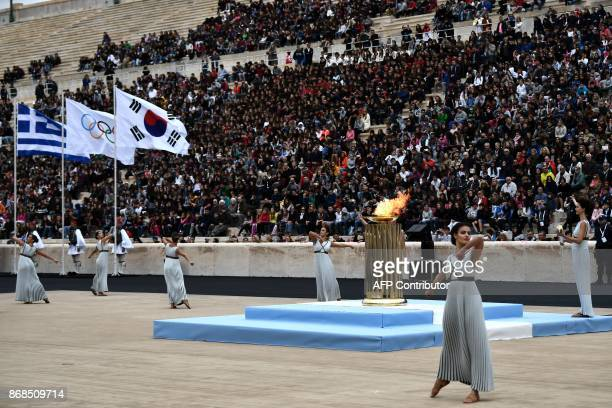 Performers are watched by spectators at The Panathenaic Stadium in Athens on October 31 during the handover ceremony of the Olympic flame for the...